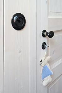 Interior door fittings with porcelain knobs and handles