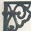 Shelf brackets made of wrought iron and brass