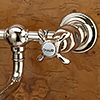 Sink faucets with patinated brass surface or with chromed or nickel-plated surfaces