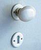 functionality: door knob fittings, , material: white porcelain, , including:, screws, , dimensions:, height knob 40 mm, width knob 63 mm, diameter rose 45 mm,