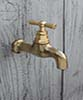 Water tap small brass patinated unvarnished length 84 mm lenght thread 10 mm height 70 mm without hose connection