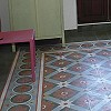 Cement floor tile with blossoms and stars